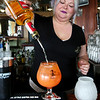 KEN YUSZKUS/Staff photo.       Victoria Station's bartender Jackie Schreibman prepares a Wharf Rat cocktail.          05/04/16