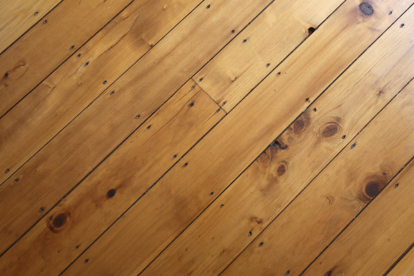 KEN YUSZKUS/Staff photo.    A close up of the wooden flooring at the home of Henry and Diane O'Donnell's  home on Lafayette Street in Salem.      04/27/16