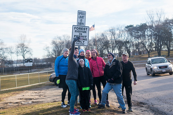 "SAM GORESH/Staff photo. Members of the Wicked Run Club pose for a photo before their ""No Rest for the Wicked"" Saturday morning run. Runners meet every Saturday at 8am at Forest River Park, with people running different distances and paces. 1/28/17"