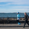 "SAM GORESH/Staff photo. Wicked Run Club members Kendra Burke and Stephen McWhirter run along Ocean Avenue in Marblehead during the ""No Rest for the Wicked"" Saturday morning run. 1/28/17"
