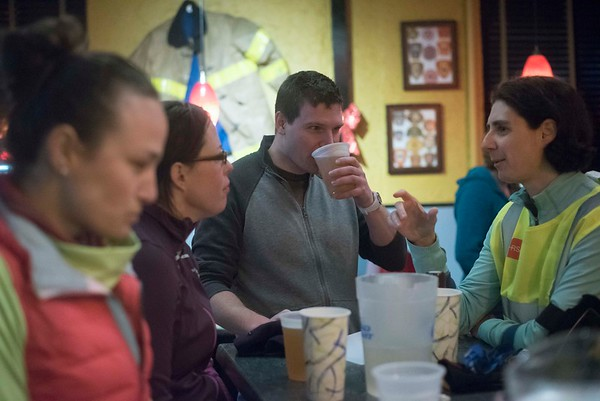 "SAM GORESH/Staff photo. Members of the Wicked Run Club hang out at the Engine Room after their ""No Rest for the Wicked"" Thursday group run. Runners have been gathering to run 3.1 miles every Thursday no matter what the weather nonstop for almost eight years. 2/2/17"