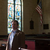 SAM GORESH/Staff photo. Reverend Jeff Barz-Snell, pastor of First Church in Salem poses for a portrait in his church. 2/1/17