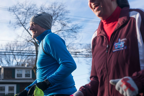 """SAM GORESH/Staff photo. Wicked Run Club members Mike Cronin an Debbie Shahdi run together during the """"No Rest for the Wicked"""" Saturday morning run. 1/28/17"""