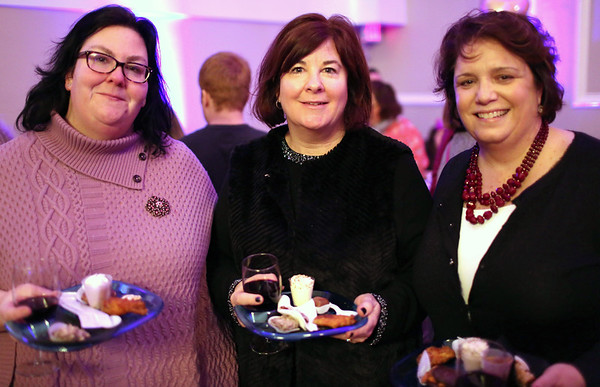 """HADLEY GREEN/ Staff photo<br /> <br /> From left to right, Marianne Smith, of Salem, Susan Mullenmeister, of Salem, and Cathy Needham, of Waltham, attend the """"Salem So Sweet"""" chocolate and wine tasting on Friday, February 10th, 2017 at Rockafellas in Salem."""