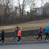 "SAM GORESH/Staff photo. From left: Wicked Run Club members Stephen McWhirter, Marissa Rodriguez, Donna Greenberg, Debbie Shahidi, and Mike Cronin run up Lafayette Street during the ""No Rest for the Wicked"" Saturday morning run. 1/28/17"