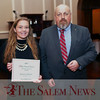 HADLEY GREEN/ Staff photo<br /> Jessica Jellison, a senior at Salem High School, stands with Dave Olson, editor of the Salem News, at the Salem News Student Athlete Award dinner on Thursday, April 6th, 2017.