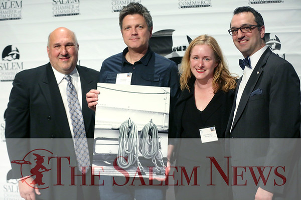 HADLEY GREEN/ Staff photo<br /> Mark Leavitt, left, president of the Salem Chamber of Commerce, and Jason Consalvo, right, past president of the chamber, present Chris Loring and Mary Ellen Leahy of Notch Brewing the award for best new business of the year at the Salem Chamber of Commerce's Celebrate Salem Awards Dinner.