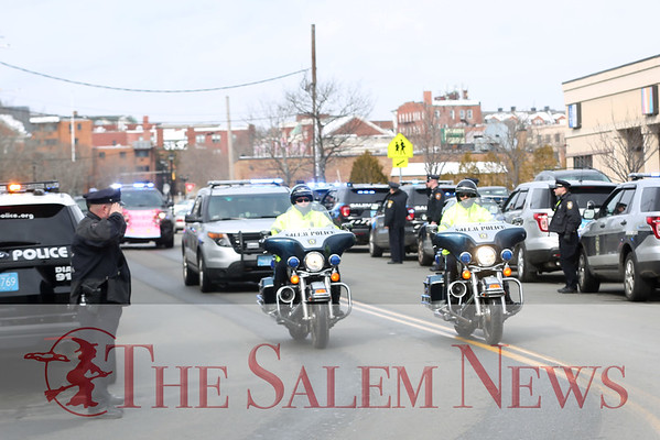 HADLEY GREEN/Staff photo<br /> Salem police give Dior Stavros, a 6-year-old girl from Salem who has leukemia, a police escort from the Bates Elementary School to the Salem Police Department. <br /> <br /> 03/09/18