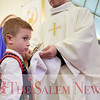 Simon Zydlowski after kissing the relic of St. John Paul II's at John Paul II Divine Mercy Shrine in Salem, Sunday, April 8, 2018. Jared Charney / Photography