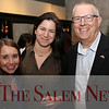 HADLEY GREEN/Staff photo<br /> From left, Kendra St. John from Lightshed Photography Studio, Katie Kwiatkowski from Salem Five, and Rinus Oosthoek from the Salem Chamber of Commerce attend the Salem Chamber of Commerce After Hours event at the Ledger Restaurant. <br /> <br /> 02/23/18