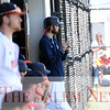 HADLEY GREEN/Staff photo<br /> Nick Jarvis watches the Salem State v. MCLA baseball game from the dugout. <br /> <br /> 04/28/18
