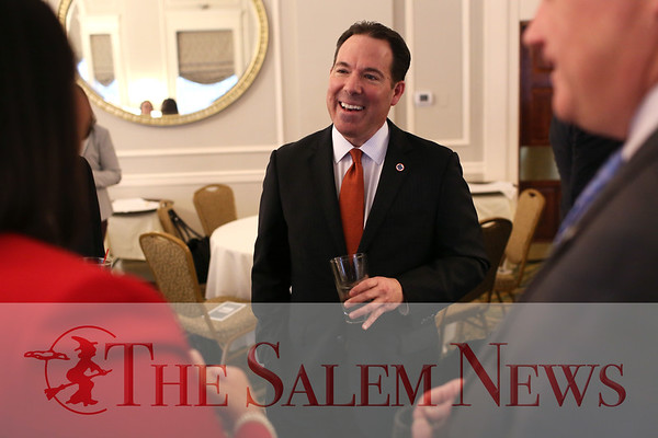 HADLEY GREEN/Staff photo<br /> Robert Rivers, CEO and chairman of Eastern Bank, speaks with Salem Mayor Kim Driscoll at the Salem Partnership's annual meeting at the Hawthorne Hotel.<br /> <br /> 03/28/18