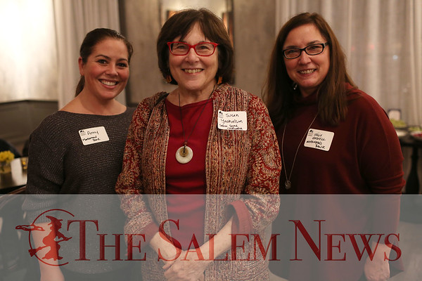 HADLEY GREEN/Staff photo<br /> From left, Amy Hart from the Marblehead Bank, Susan Yochelson from Salem Sound Coastwatch, and Julie Haskhell from the Marblehead Bank attend the Salem Chamber of Commerce After Hours event at the Ledger Restaurant. <br /> <br /> 02/23/18