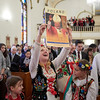 Maria Konarski holds up a Pope John Paul II poster at the presentation of St. John Paul II's relic at John Paul II Divine Mercy Shrine in Salem, Sunday, April 8, 2018. Jared Charney / Photography