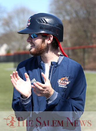 HADLEY GREEN/Staff photo<br /> Nick Jarvis claps for his teammates while seniors on the team were recognized at Salem State's baseball game against MCLA. <br /> <br /> 04/28/18