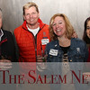 HADLEY GREEN/Staff photo<br /> From left, Michael Zero from Stadium Oil, Steve Orne from Rumson's Rum, Alyse Barbash from Rumson's Rum, and Rhonda Zero from Stadium Oil attend the Salem Chamber of Commerce After Hours event at the Ledger Restaurant. <br /> <br /> 02/23/18