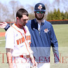 HADLEY GREEN/Staff photo<br /> Salem State baseball team's Nick Jarvis encourages his teammate Brendan Greene (3) at the Salem State v. MCLA baseball game. <br /> <br /> 04/28/18