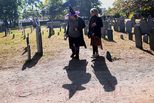 HADLEY GREEN/Staff photo<br /> People stroll through Salem's Charter Street Cemetery during Salem's Haunted Happenings in downtown Salem. <br /> <br /> 10/27/17