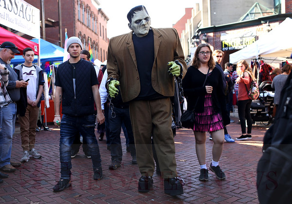 HADLEY GREEN/Staff photo<br /> Frankenstein made an appearance on Essex Street during Salem's Haunted Happenings in downtown Salem on Saturday afternoon.<br /> <br /> 10/28/17