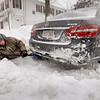 BRYAN EATON/Staff Photo. One High Street resident in Newburyport gets down and dirty to clean up from under his car.