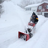 KEN YUSZKUS/Staff photo.    Ken Hewitt of Londonderry snowblows his driveway Tuesday morning.  1/27/15