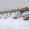 Desi Smith/Staff Photo.    Snow drifts pile up on the front of the school buses parked at the O'maley School during the blizzard Tuesday morning.<br />  January 27,2015