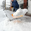 CARL RUSSO/Staff photo. Al Gallo of Derry shovels in front of his apartment on Franklin Street at the start of Saturday's snowstorm. 1/24/2015.