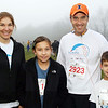 Andover:  The Neal family of Andover participated in the race, from left, Cheryl Neal, daughter Megan, 11,<br /> John Neal and son Ryan, 9,<br /> at the Feaster Five Road Race, Thanksgiving morning, Shawsheen Square in Andover.<br /> 11-26-09                         Photo by Frank J. Leone, Jr.