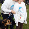 """Andover:  Jeanie Liddell and her daughter Sabria, 7, along with dog """"Ginger"""", joined in the race, all are from  Andover,<br /> at the Feaster Five Road Race, Thanksgiving morning, Shawsheen Square in Andover.<br /> 11-26-09                         Photo by Frank J. Leone, Jr."""