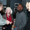 """City Desk, Andover:<br /> Catching-up at the screening, from left, Barry and Patti McCloskey, Leon Modeste and Kevin O'Connor, all of<br /> Andover and Phillips Academy Andover faculty,<br /> at the private screening of """"Delta Rising"""", a blues documentary, co-written, directed and produced by Andover's<br /> Laura Bernieri, Wednesday, at Glory Restaurant, Andover.<br /> 12-17-08                            Photo by Frank J. Leone, Jr."""