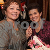 At left, Tish Bachmann, chairperson, with Janice Goldstein, both of Andover, holding Stepping Out in Style shoes,<br /> at the Quota International of Andover's Stepping Out in Style to benefit disadvantaged women and children in the Merrimack Valley,<br /> Saturday, at the Lanam Club, Andover.<br /> 11-13-10,  Photo by Frank J. Leone, Jr.