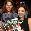 Andover:  Enjoying the magazine, at left, Patricia Kungie of North Andover and<br /> Saghi Bozergzad of Andover,<br /> at the ANDOVERS Magazine Hottest Bachelorette Contest Party, Friday, at Serene Restaurant, Andover.<br /> 7-31-09                 Photo by Frank J. Leone, Jr.