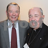 North Andover:  Dick Cain, ' 59,  catches up with Rev. Jim Wenzel, OSA, director of Center for Augustinian Study and Legacy,<br /> both are from North Andover,<br /> at the first Volunteer of Year Award, reception and dinner, Thursday, at Merrimack College, North Andover.<br /> 9-10-09                            Photo by Frank J. Leone, Jr.