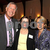 City Desk, North Andover:  At left, Dr. Robert Cuomo, ' 68, of North Andover, dean of the Girard Business School, honoree Arleen<br /> Bradley, ' 94, of Lawrence and Nancy Clark of North Andover, director of alumni relations, enjoyed the evening,<br /> at the first Volunteer of Year Award, reception and dinner, Thursday, at Merrimack College, North Andover.<br /> 9-10-09                            Photo by Frank J. Leone, Jr.