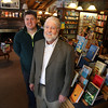AMY SWEENEY/Staff photo.  John Hugo, left, stands with his father Bob in the Andover Bookstore that received $1,000 grant from best-selling author James Patterson who is helping independent booksellers stay afloat.  Bob has owned the store since 1990. 3/3/2014
