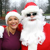 Andover:  Showing their Holiday spirit, at left, Susan Hurley and Max McGillivray, both of North Andover,<br /> at the Feaster Five Road Race, Thanksgiving morning, Shawsheen Square in Andover.<br /> 11-26-09                         Photo by Frank J. Leone, Jr.