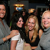 City Desk, Andover:  Sharing smiles, from left, Alyssa Rosenblatt and Kristen DeLuca, both of Andover,<br /> Kimberly Sapienza of Boston and Patricia Pappucci of North Andover,<br /> at the 10year Anniversary Bash of Glory Restaurant in Andover.<br /> 1/25/09                                     Photo by Frank J. Leone, Jr.