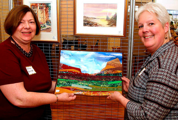 City Desk, North Andover:  At left, Andover artist Elaine Meisinger with<br /> artist Leslie Young-Lemire of North Andover and<br /> her landscape quilt<br /> at the 5th annual Andover Artists Guild Wine and Art Show to benefit the<br /> North Parish Restoration Fund, Saturday,<br /> at the North Parish Church, North Andover.<br /> 3-22-08                       Photo by Frank J. Leone, Jr.