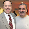 At left, Mark Denehy of Andover, Merrimack's Hockey Coach and Bill Buco of North Andover and McAloons Liquors,<br /> catch-up before the UNH match-up,<br /> at the Friends of Merrimack College Blue Line Club Reception and hockey game for friends and donors, Friday, at Volpe Athletic Complex, North Andover.<br /> 1-29-10                                        Photo by Frank J. Leone, Jr.