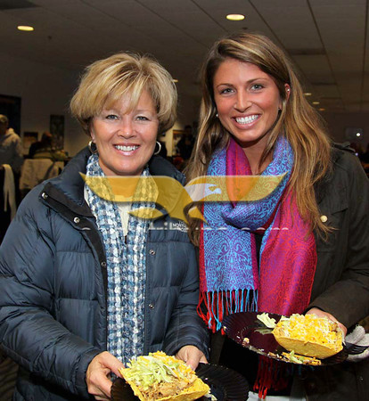 Andover:  Enjoying the taco buffet, at left, Kristen Bruno and her daughter Liz Bruno, both of Andover, at the Friends of Merrimack Hockey Night at the Blue Line Club, Lawler Rink, Merrimack College, North Andover.<br /> 1-18-11,  Photo by Frank J. Leone, Jr.