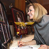 City Desk, Andover:  Lisa Nardone of Andover bids on a Tom Brady auction item,