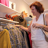 Photo by Frank J. Leone, Jr.   Nula Carlson of Andover, checks out a Tizzie long sleeve fall fashion shirt at Irresistibles,   <br /> at the Andover Fashion Night, Fall Fashions, Thursday, Downtown Andover.