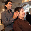 Photo by Frank J. Leone, Jr.   Jose'  Batistine, of Andover, proprietor and hair stylist at Indra Salon, adds fall fashion tones <br /> to Emma Campbell of Haverhill,   <br /> at the Andover Fashion Night, Fall Fashions, Thursday, Downtown Andover.<br /> 9/6/12