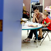Photo by Angie Beaulieu. Julia Upton, Lead Special Education Teacher, works with Joseph Beaulieu, 6, at Melmark in Andover.
