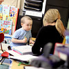 Photo by Angie Beaulieu. Declan McCullough, 6, listens as Carla Hopkinson, an Applied Behavior Analysis Councilor, works with him at Melmark in Andover.