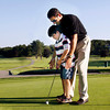 Andover:<br /> Charlie Alex, 8, gets help from his father, Jim, as he practices putting at Andover Country Club Tuesday afternoon. Charlie is autistic and will be present July 28th for the 3rd Annual Fore Melmark New England, a golfing fundraiser started by Jim and Angela Alex for Melmark which is a school serving children with autism and other challenging behaviors. <br /> Photo by Roger Darrigrand/Eagle-Tribune Tuesday, July 15, 2008