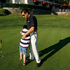Andover:<br /> Charlie Alex, 8, embraces his father, Jim, after making a shot while putting at Andover Country Club Tuesday afternoon. Charlie is autistic and will be present July 28th for the 3rd Annual Fore Melmark New England, a golfing fundraiser started by Jim and Angela Alex for Melmark which is a school serving children with autism and other challenging behaviors. <br /> Photo by Roger Darrigrand/Eagle-Tribune Tuesday, July 15, 2008