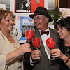 """Photo by Frank J. Leone, Jr.   At left, Tish Bachmann, Quota president elect, with Skip and Camille Wilkins, toast<br /> the evening, all are from Andover,<br /> at the Quota International of Andover's """"An Evening in Casablanca"""" Benefit, Saturday, Lanam Club, Andover.<br /> 11/5/11"""