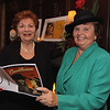 """Photo by Frank J. Leone, Jr.   At left, Quota president, Louise Hadad and board member Beth Poulo, both of Andover, review the event's program book, at the Quota International of Andover's """"An Evening in Casablanca"""" Benefit, Saturday, Lanam Club, Andover.<br /> 11/5/11"""