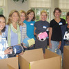From left, Min Wang, Susan Howell, Cristina Suarez, Marian Jacobson, Alessandra Herman, Lisa Hill, Lori Kelley All PSPA, Andover, Mass., October 3, 2011 – The Harvard Club of Andover teamed up with Parents of Students at Phillips Academy (PSPA) to donate sports equipment to needy kids in Haiti on Non Sibi Day.